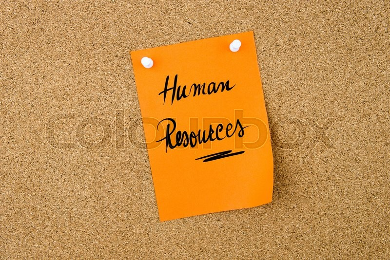 Stock image of 'Human Resources written on paper note  orange  paper note pinned on cork board with white thumbtacks, copy space available'