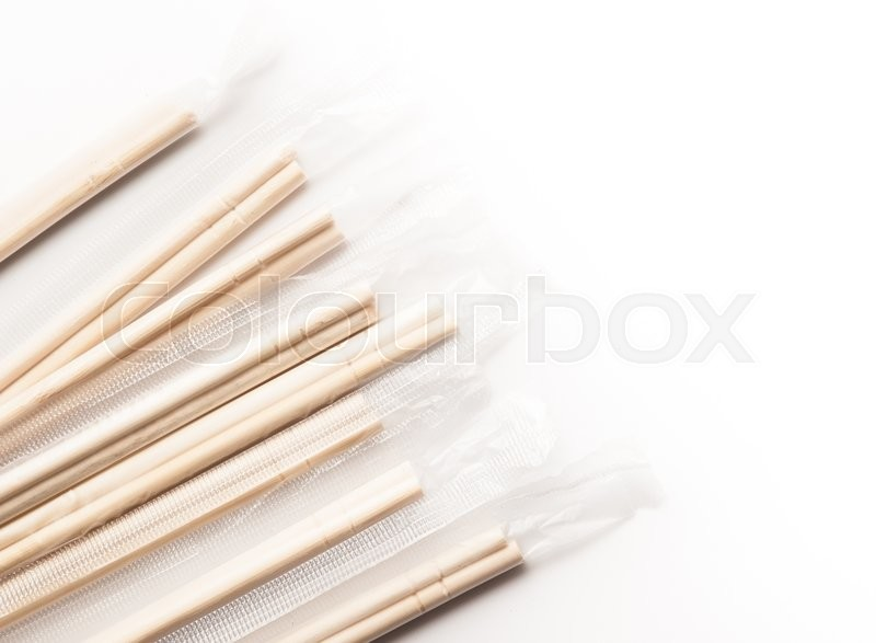 Stock image of 'Wooden pairs of chopsticks on white background'