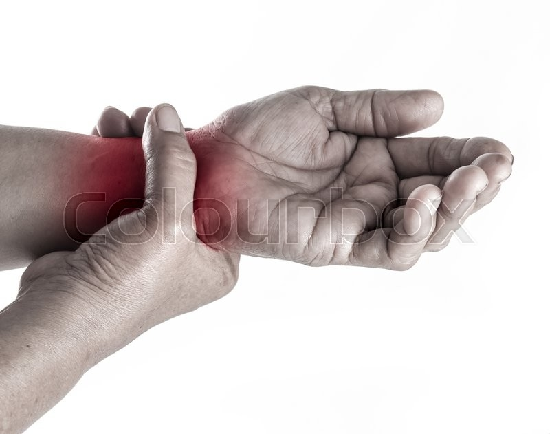 Stock image of 'Senior woman touching her injured wrist on white background,suffering pain concept'