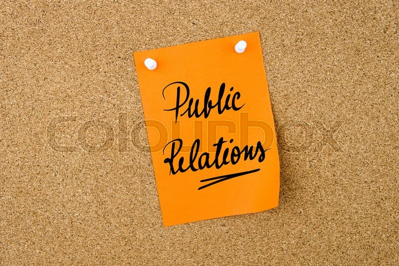 Stock image of 'Public Relations written on orange paper note pinned on cork board with white thumbtacks, copy space available'