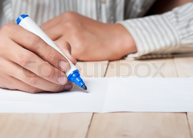Stock image of 'Close-up of Human Hand holding pen Signing on Formal Paper at the Table,Retro Filter Effect.'