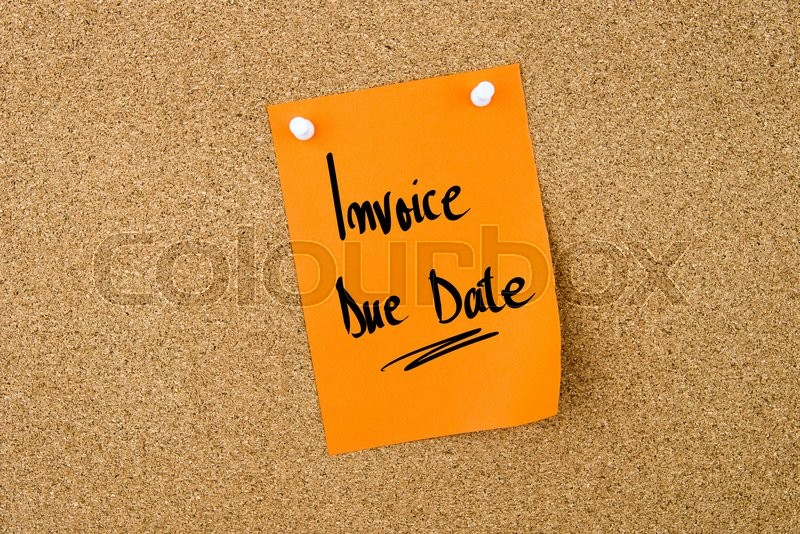 Stock image of 'Invoice Due Date written on orange paper note pinned on cork board with white thumbtacks, copy space available'