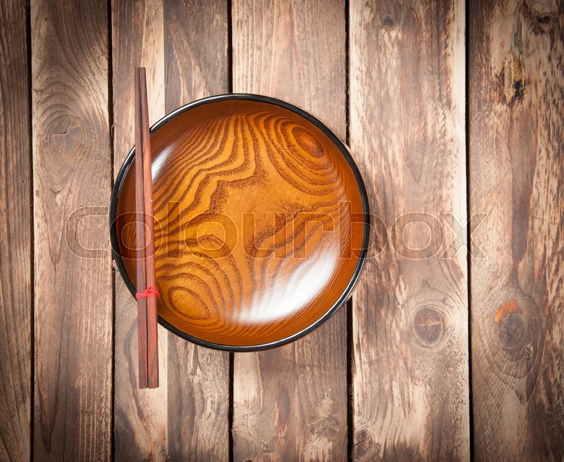 Stock image of 'Chopsticks and Empty bowl on wooden,Top view'