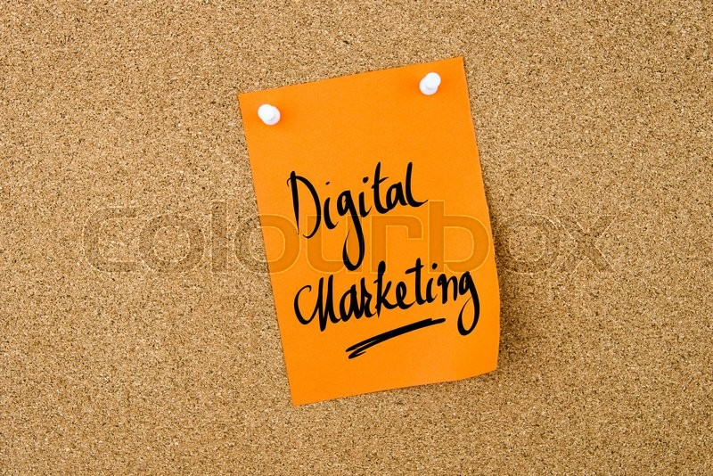 Stock image of 'Digital Marketing written on orange paper note pinned on cork board with white thumbtacks, copy space available'