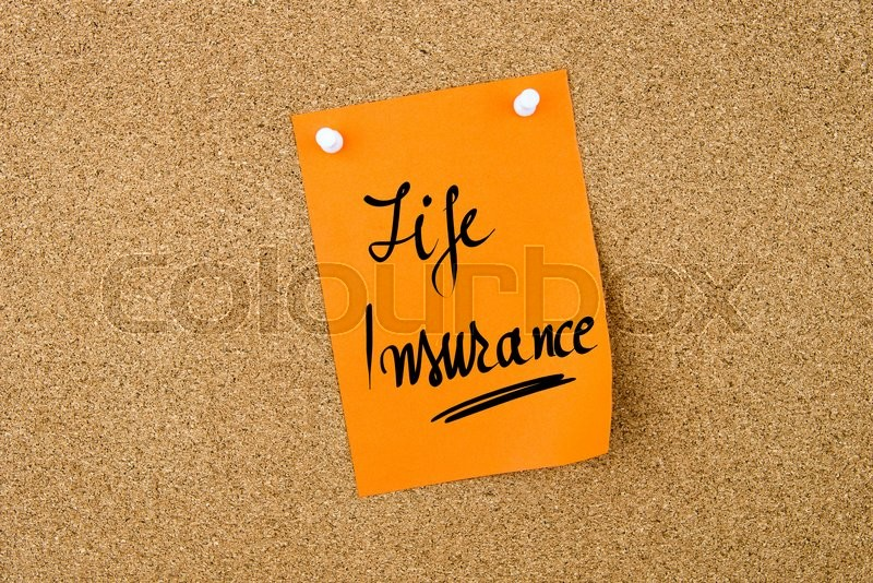 Stock image of 'Life Insurance written on orange paper note pinned on cork board with white thumbtacks, copy space available'