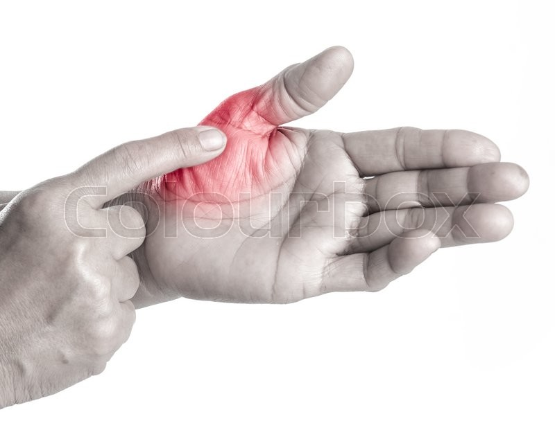 Stock image of 'Senior woman touching her injured finger on white background,suffering pain concept'
