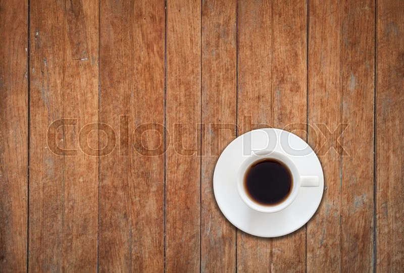 Stock image of 'Top view of white coffee cup on wooden background, stock photo'