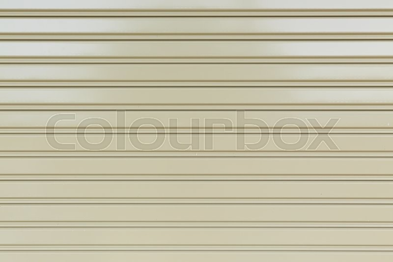 Stock image of 'steel metal door, roller shutter door in warehouse building'