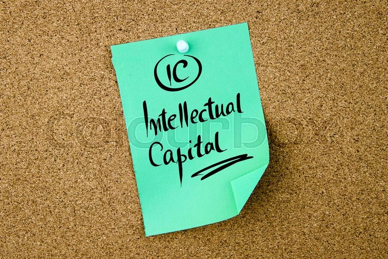 Stock image of 'Business Acronym IC Intellectual Capital written on green paper note pinned on cork board with white thumbtack, copy space available'