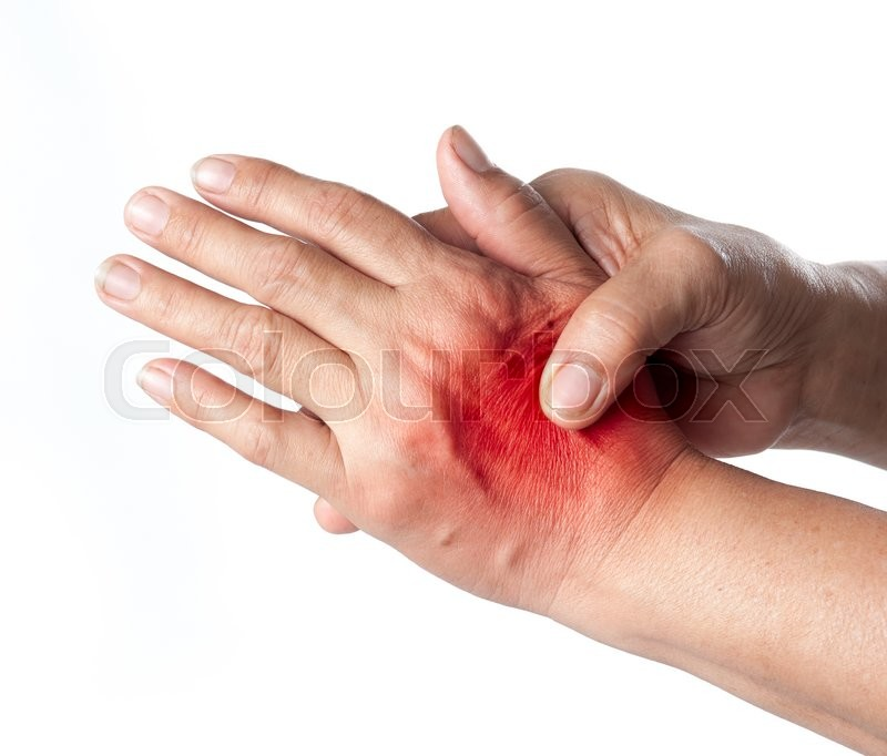 Stock image of 'Senior woman touching her injured hand on white background,suffering pain concept'