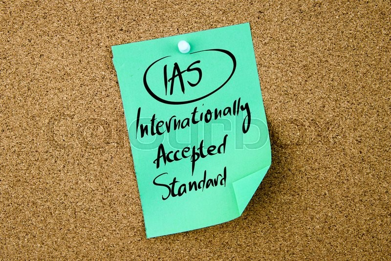 Stock image of 'Business Acronym IAS Internationally Accepted Standard written on green paper note pinned on cork board with white thumbtack, copy space available'