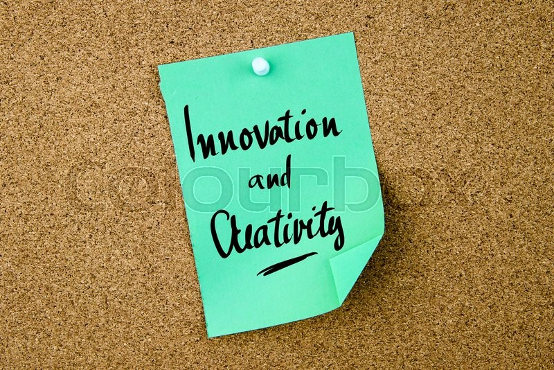 Stock image of 'Innovation and Creativity written on green paper note pinned on cork board with white thumbtacks, copy space available'
