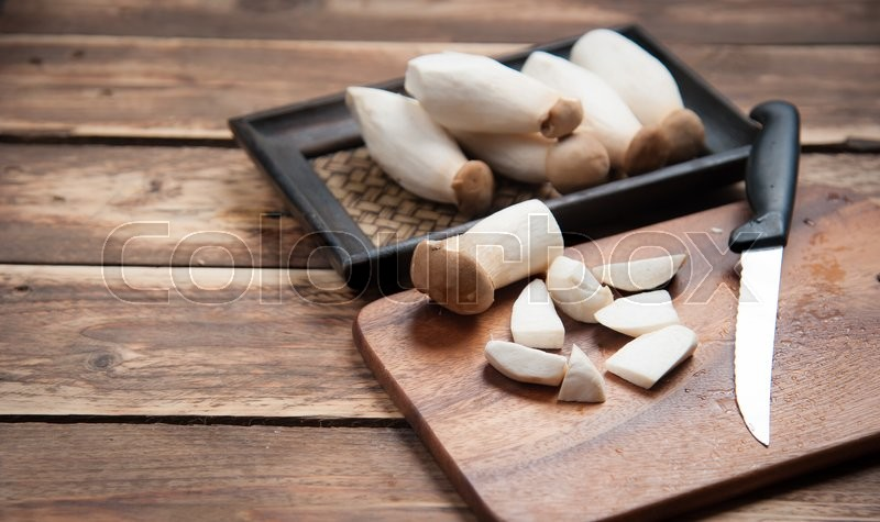 Stock image of 'Small pieces King Oyster mushroom (Eringi) on wood backgroud.'