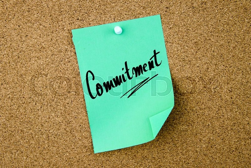 Stock image of 'Commitment written on green paper note pinned on cork board with white thumbtacks, copy space available'
