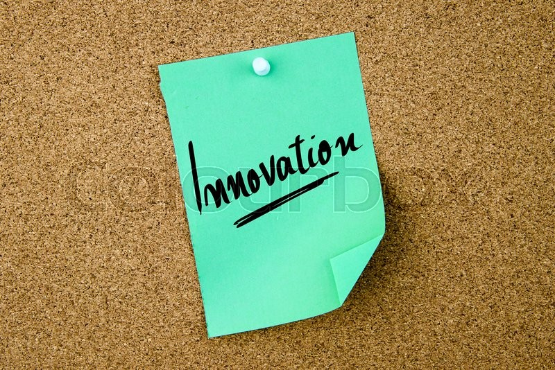 Stock image of 'Innovation written on green paper note pinned on cork board with white thumbtacks, copy space available'