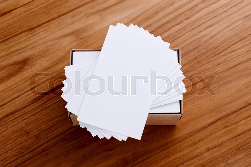 Stock image of 'Business card blank stack mockup with kraft box on wood desk'