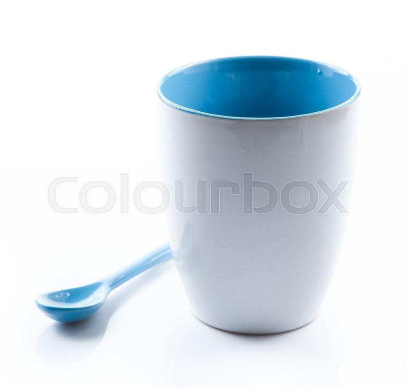 Stock image of 'Cup and spoon on white background'