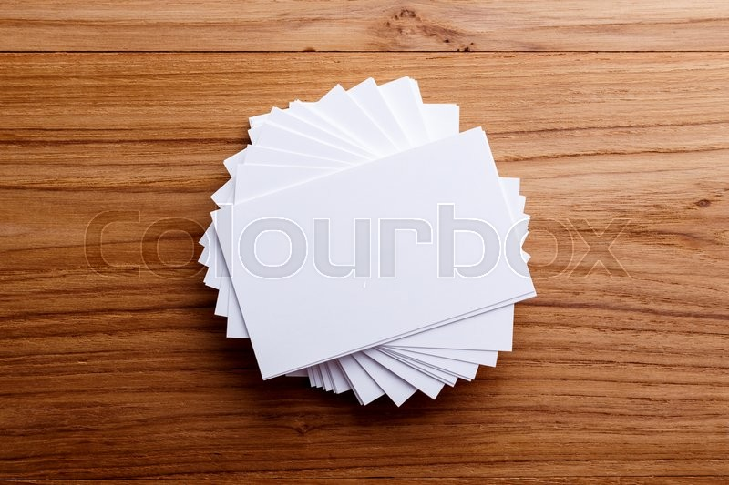 Stock image of 'Business card stack blank mockup on wood desk'