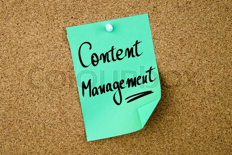 Stock image of 'Content Management written on green paper note pinned on cork board with white thumbtacks, copy space available'
