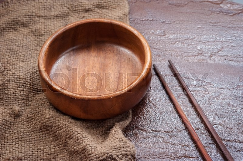 Stock image of 'Empty  bowl with chopsticks on stone background,Top view'