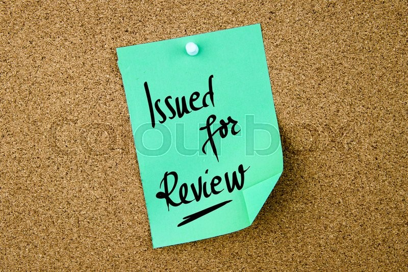Stock image of 'Issued For Review written on green paper note pinned on cork board with white thumbtacks, copy space available'