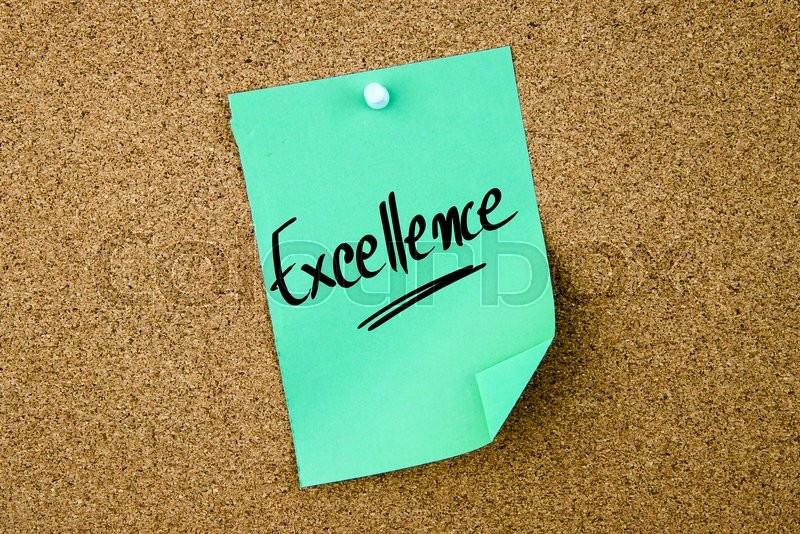 Stock image of 'Excellence written on green paper note pinned on cork board with white thumbtacks, copy space available'