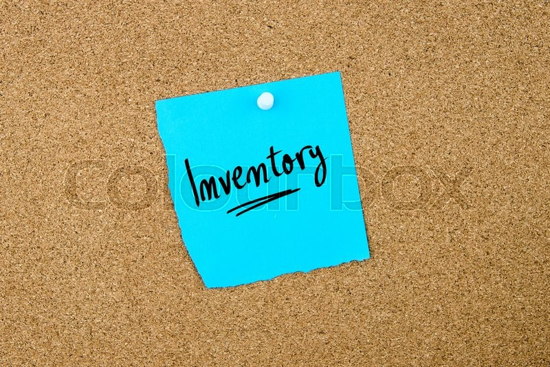 Stock image of 'Inventory written on blue paper note pinned on cork board with white thumbtacks, copy space available'