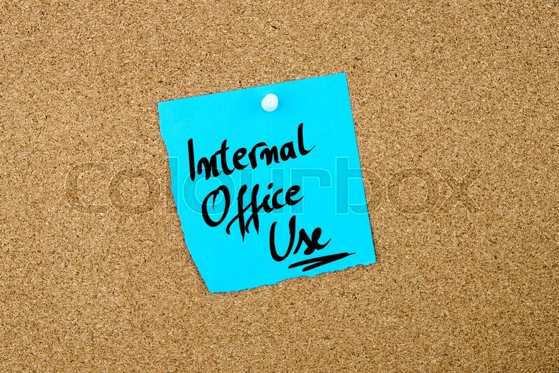 Stock image of 'Internal Office Use written on blue paper note pinned on cork board with white thumbtacks, copy space available'