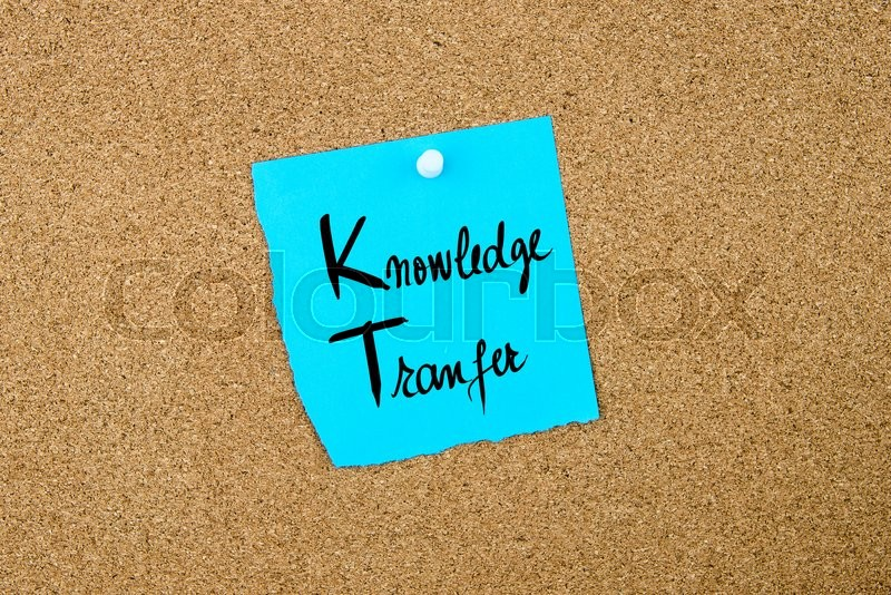 Stock image of 'Business Acronym  KT as Knowledge Transfer written on blue paper note pinned on cork board with white thumbtack, copy space available'