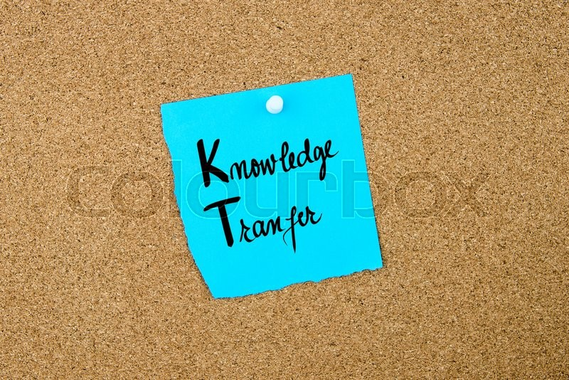 Stock image of 'Business Acronym KT Knowledge Transfer written on blue paper note pinned on cork board with white thumbtack, copy space available'