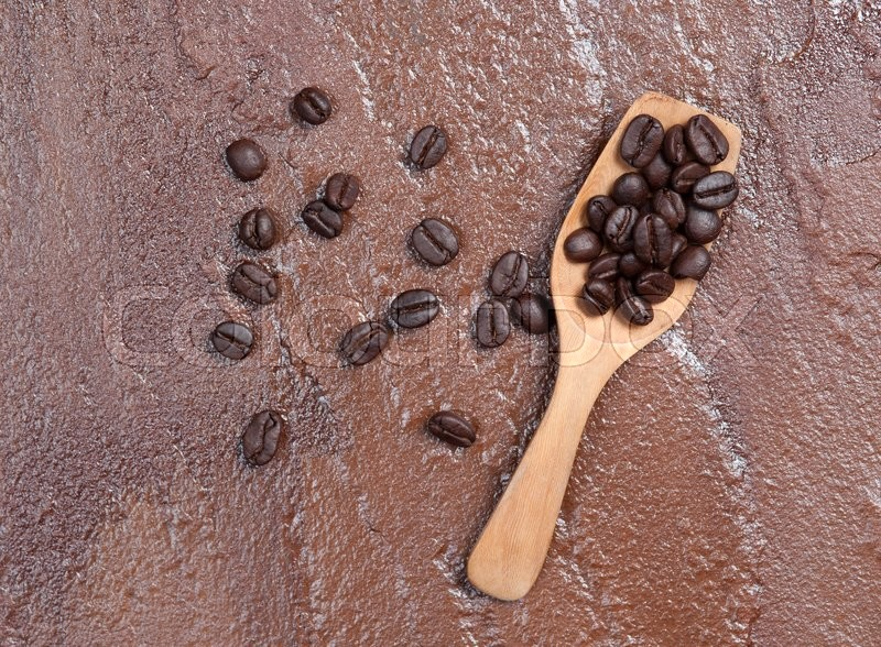 Stock image of 'Coffee beans on a stone background.'