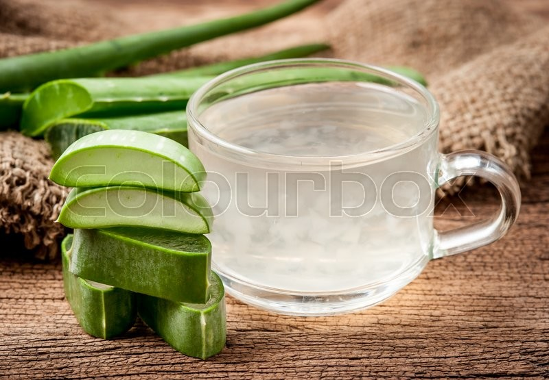 Stock image of 'Aloe Vera Healthy drink on wooden background'