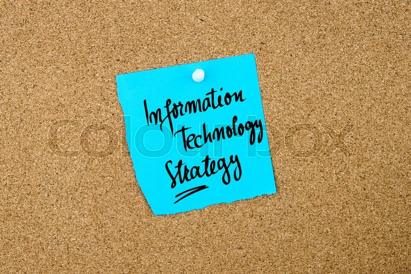 Stock image of 'Information Technology Strategy written on blue paper note pinned on cork board with white thumbtacks, copy space available'