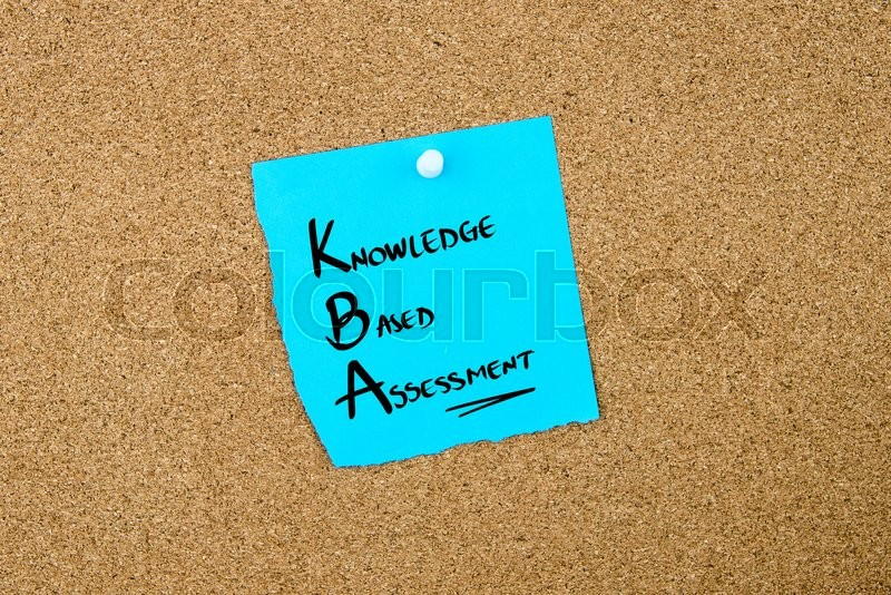 Stock image of 'Business Acronym KBA Knowledge Based Assessment written on blue paper note pinned on cork board with white thumbtack, copy space available'