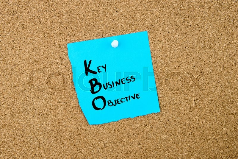 Stock image of 'Business Acronym  KBO Key Business Objective written on blue paper note pinned on cork board with white thumbtack, copy space available'