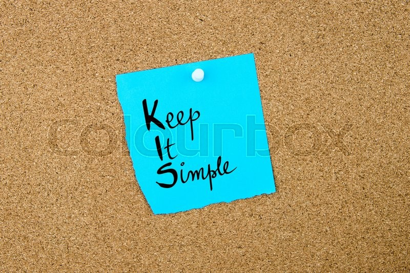 Stock image of 'Business Acronym KIS Keep It Simple written on blue paper note pinned on cork board with white thumbtack, copy space available'