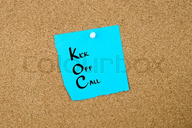 Stock image of 'Business Acronym KOC Kick Off Call written on blue paper note pinned on cork board with white thumbtack, copy space available'