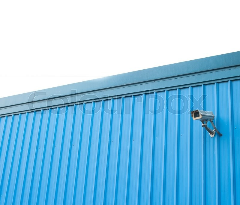 Stock image of 'Security cctv camera in metal wall'