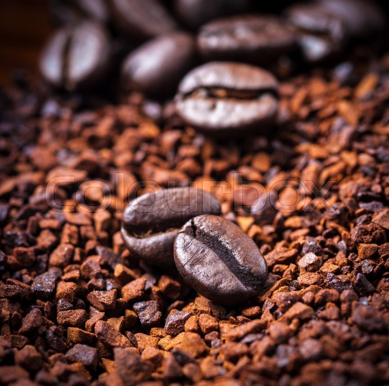 Stock image of 'Coffee bean on ground coffee background.'
