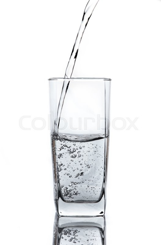 Stock image of 'Pouring water on glass on white background'