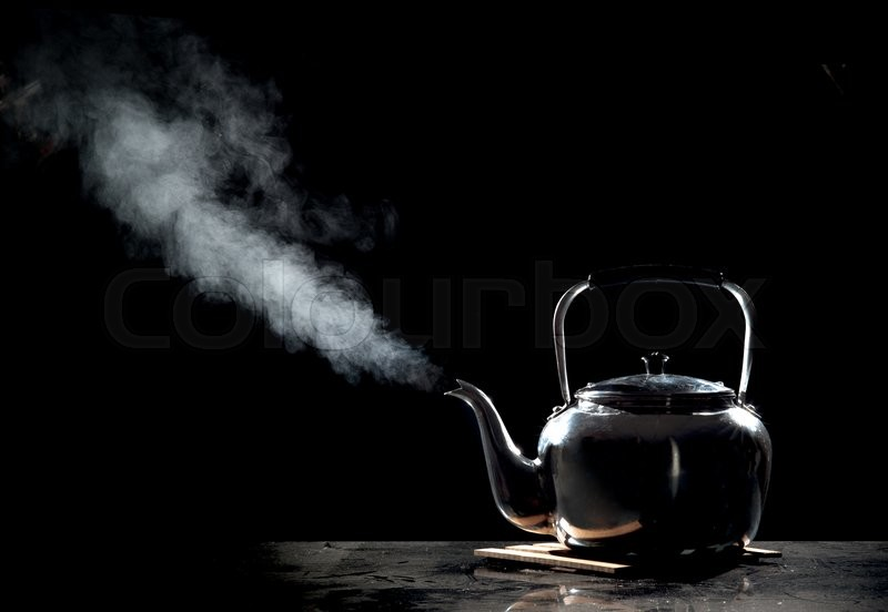 Stock image of 'Tea kettle with boiling water on a black background'