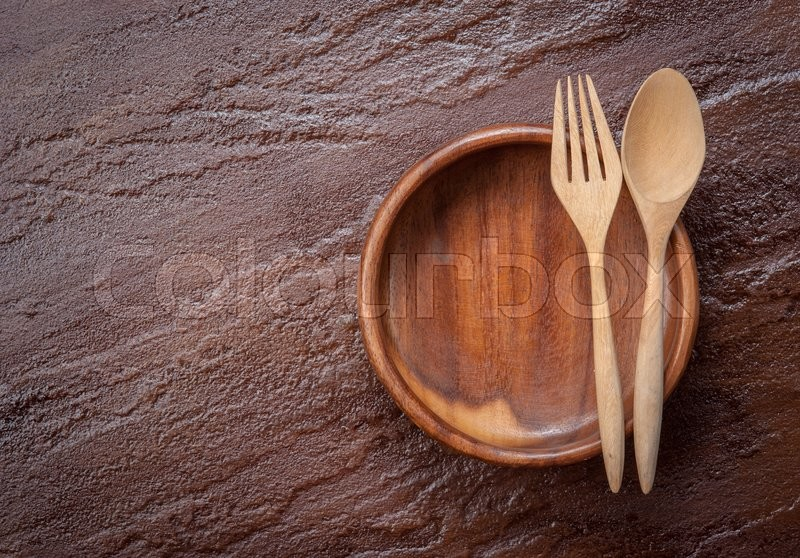 Stock image of 'Empty  bowl with fork and spoon on stone background,Top view'