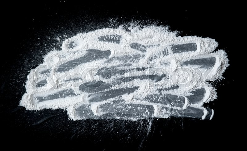 Stock image of 'Talcum Powder on a black slate'