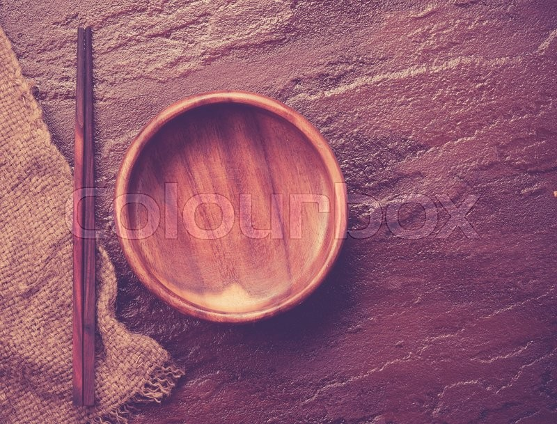 Stock image of 'Empty  bowl with chopsticks on stone background,vintage color toned image'