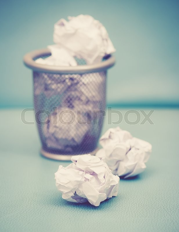 Stock image of 'Recycle,trash bin and crumpled paper balls; vintage tone style'