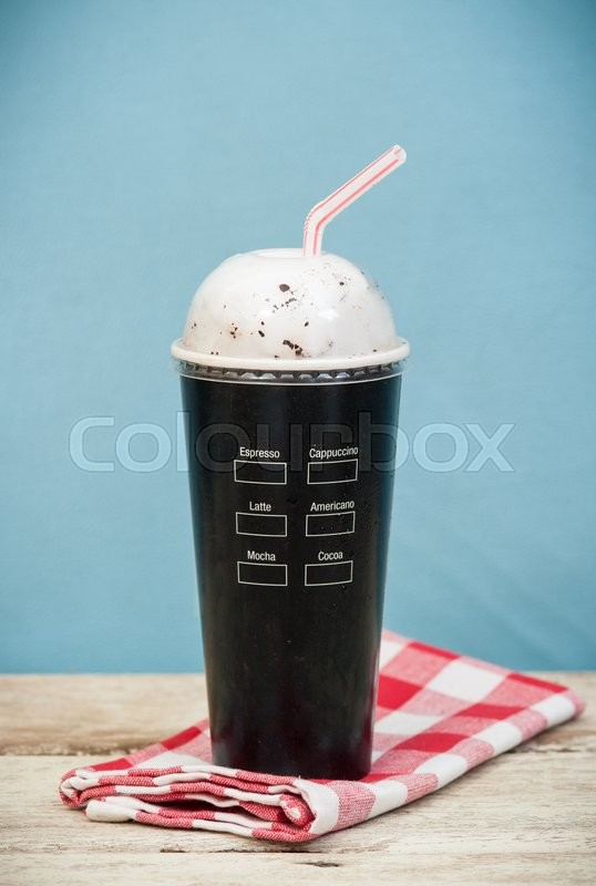 Stock image of 'Iced coffee vintage background,Selective focus on paper cup'