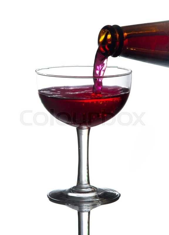 Stock image of 'Red wine pouring into wine glass'