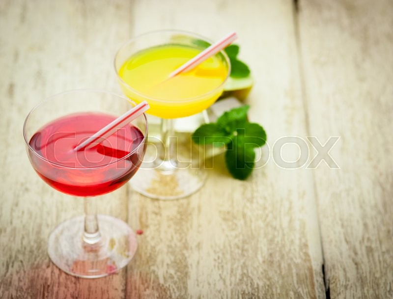 Stock image of 'Various alcoholic cocktails on wood'