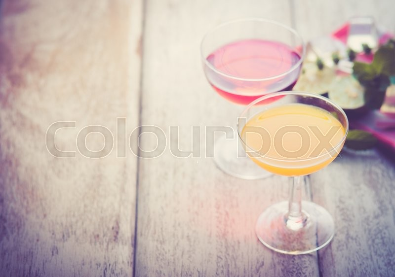 Stock image of 'Various alcoholic cocktails on wood,vintage color toned image'