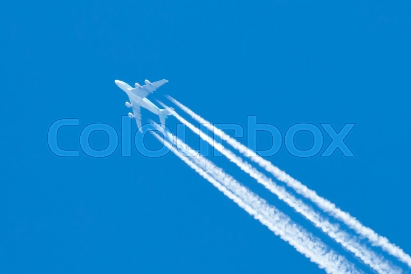 Stock image of 'Large aircraft flying in sky, 4 stripes in the sky'